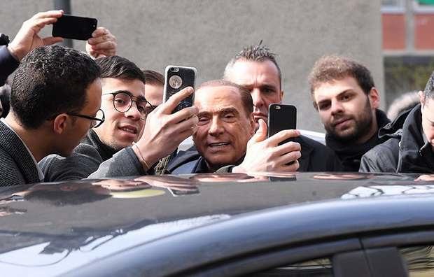Коалиция Берлускони лидирует на парламентских выборах в Италии